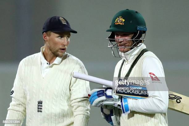 Joe Root of England talks to Peter Handscomb of Australia at the conclusion of play during day three of the Second Test match during the 2017/18...