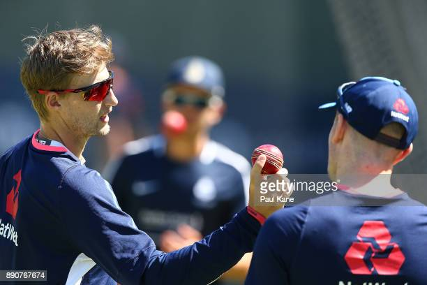 Joe Root of England talks with Mason Crane during an England nets session ahead of the Third Test in the 2017/18 Ashes series at WACA on December 12...