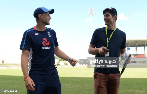 Joe Root of England talks with Sir Alastair Cook before a training session at the Sir Vivian Richards Stadium before the second Test match between...