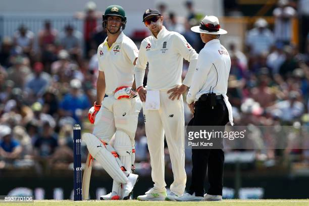Joe Root of England talks with umpire Chris Gaffaney after calling for a referral during day three of the Third Test match during the 2017/18 Ashes...