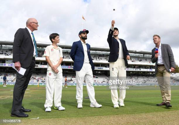 Joe Root of England tosses the coin as Virat Kohli of India watches prior to the start of play on Day Two of the Specsavers 2nd Test match between...