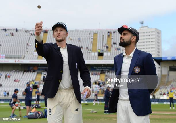 Joe Root of England tosses the coin watched by Virat Kohli of India before the 1st Specsavers Test Match between England and India at Edgbaston on...