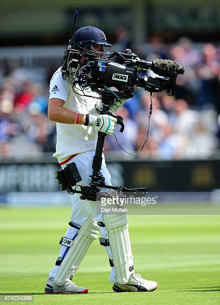 Joe Root of England uses a television camera after colliding with it's operator during day one of the 1st Investec Test match between England and New...