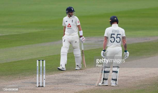 Joe Root of England walks off after being dismissed watched on by Ben Stokes during Day Four of the 1st #RaiseTheBat Test Match between England and...