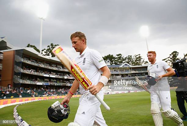 Joe Root of England walks off for bad light after scoring his century with Jonny Bairstow of England during day two of the 3rd Test at Wanderers...