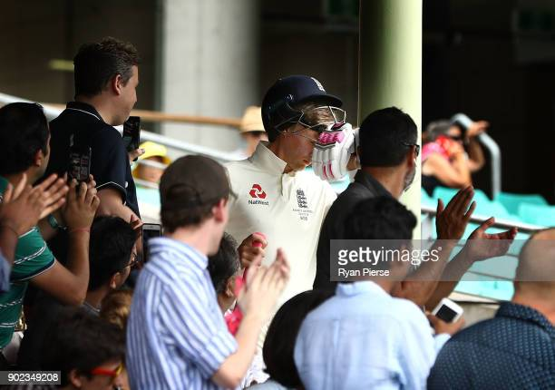 Joe Root of England walks out to bat after being discharged from hospital after suffering severe dehydration during day five of the Fifth Test match...