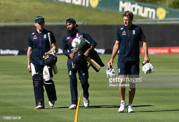 Joe Root of England walks towards the nets with Adil Rashid and Eoin Morgan during a Net Session at Newlands Cricket Ground on December 03, 2020 in...