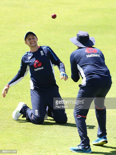 Joe Root of England works on a catching drill with Trevor Bayliss head coach during an England training session at the WACA on October 31 2017 in...