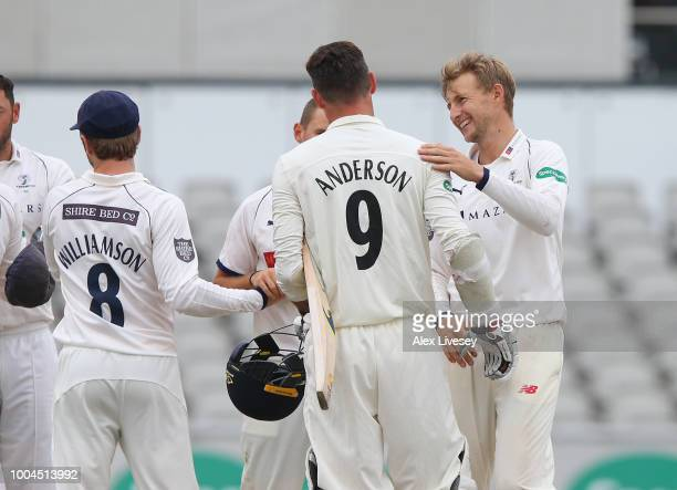 Joe Root of Yorkshire and James Anderson of Lancashire shake hands after the Specsavers Championship Division One match between Lancashire and...