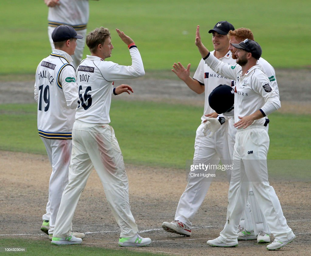 Joe Root (L) of Yorkshire celebrates after he takes the wicket of Jos Buttler of Lancashire during day two of the Specsavers County Championship division one match between Lancashire and Yorkshire at Emirates Old Trafford on July 23, 2018 in Manchester, England.