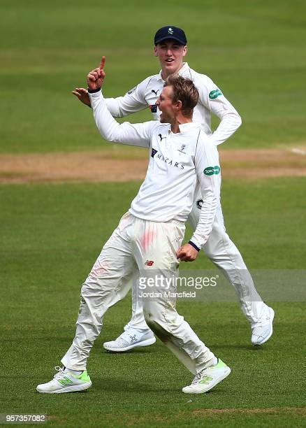 Joe Root of Yorkshire celebrates dismissing Dean Elgar of Surrey during day one of the Specsavers County Championship Division One match between...