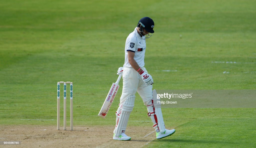 Joe Root of Yorkshire leaves the field after being caught for 0 by Alastair Cook of Essex during day one of the Specsavers County Championship Division One cricket match between Essex and Yorkshire at the Cloudfm county ground on May 4, 2018 in Chelmsford, England.