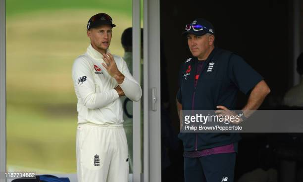 Joe Root talks to Chris Silverwood of England before the start of play at Cobham Oval on November 15 2019 in Whangarei New Zealand