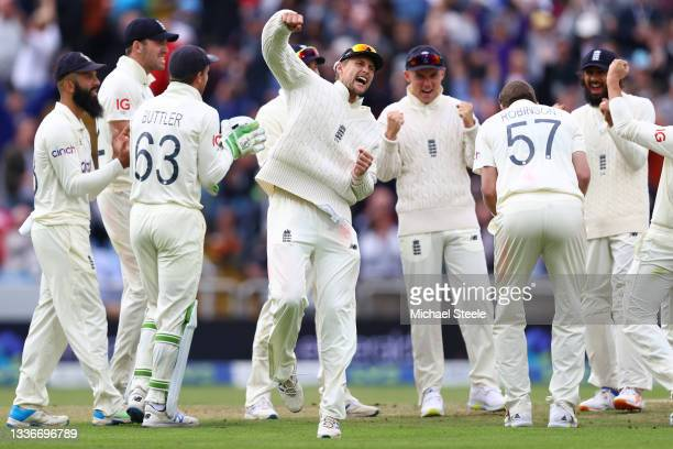 Joe Root the captain of England celebrates the lbw review decision and wicket of Rohit Sharma during day three of the Third Test Match between...