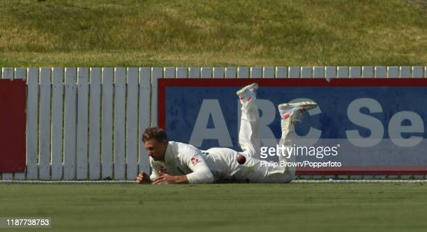Joe Root the England captain is injured as he dives to stop four runs at Cobham Oval on November 15 2019 in Whangarei New Zealand