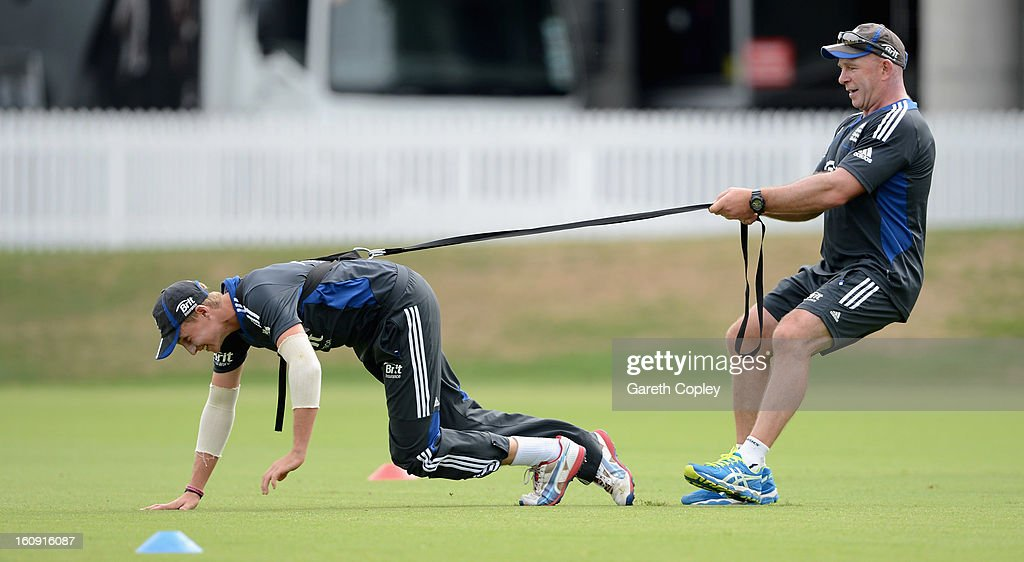 Joe Root warms up with fitness coach Huw Bevan during an England nets session at Eden Park on February 8, 2013 in Auckland, New Zealand.