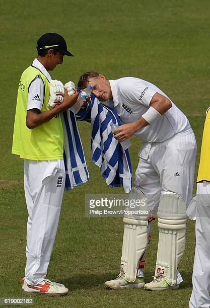 Joe Root wipes his eye as Haseeb Hameed holds the towel during the second day of the second test match between Bangladesh and England at Shere Bangla...