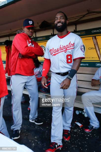 Joe Ross and Brian Goodwin of the Washington Nationals stand in the dugout prior to the game against the Oakland Athletics at the Oakland Alameda...