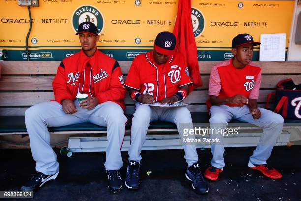 Joe Ross and Manager Dusty Baker of the Washington Nationals sit in the dugout with Darren Baker prior to the game against the Oakland Athletics at...