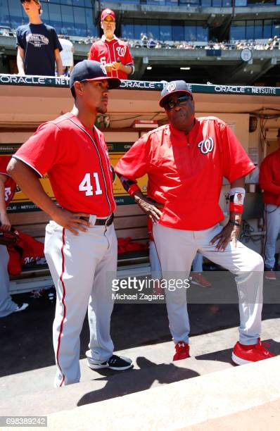 Joe Ross and Manager Dusty Baker of the Washington Nationals talk the dugout prior to the game against the Athletics at the Oakland Alameda Coliseum...
