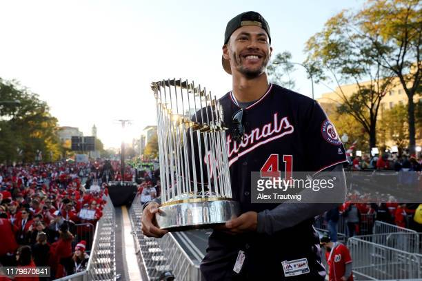 Joe Ross of the Washington Nationals poses for a photo with the Commissioner's Trophy during the 2019 World Series victory parade on Saturday...