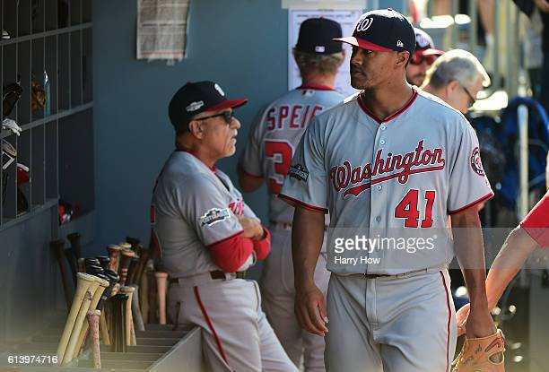 Joe Ross of the Washington Nationals reacts in the dugout after being pulled from the game in the third inning against the Los Angeles Dodgers during...