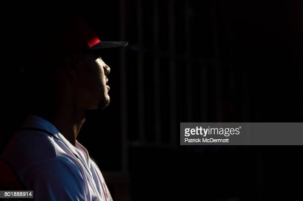Joe Ross of the Washington Nationals sits in the dugout in the seventh inning during a game against the Cincinnati Reds at Nationals Park on June 24...