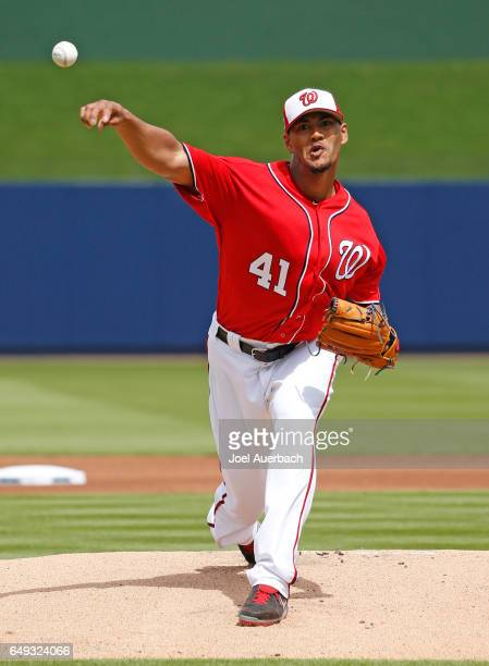 Joe Ross of the Washington Nationals throws the ball against the Boston Red Sox in the first inning during a spring training game at The Ballpark of...