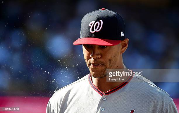 Joe Ross of the Washington Nationals walks from the mound in the second inning against the Los Angeles Dodgers during game four of the National...