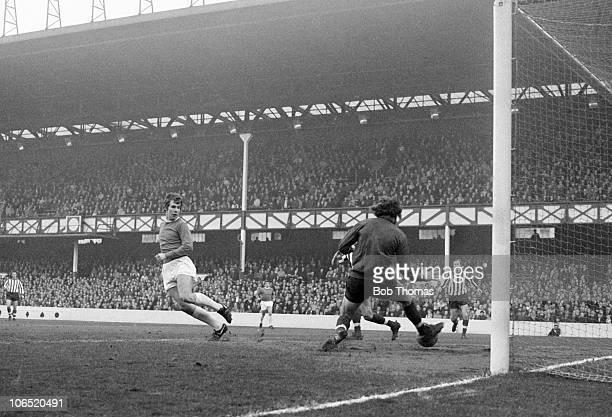 Joe Royle of Everton scores past the Southampton goalkeeper Eric Martin during their Division One match held at Goodison Park Everton on 12th...
