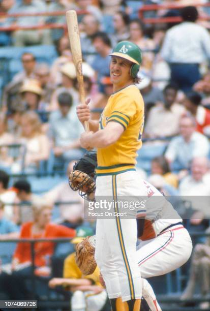 Joe Rudi of the Oakland Athletics looks down at the third base coach of a sign against the Baltimore Orioles during a Major League Baseball game...