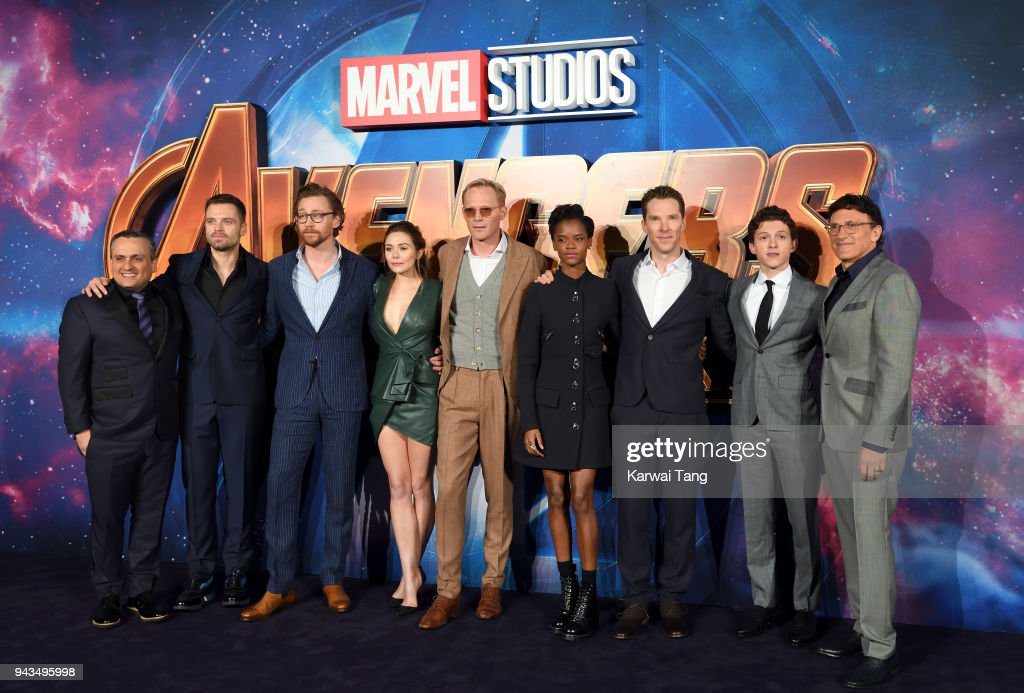 Joe Russo, Sebastian Stan, Tom Hiddleston, Elizabeth Olsen, Paul Bettany, Letitia Wright, Benedict Cumberbatch, Tom Holland and Anthony Russo attend the UK Fan Event for 'Avengers Infinity War' at Television Studios White City on April 8, 2018 in London, England.