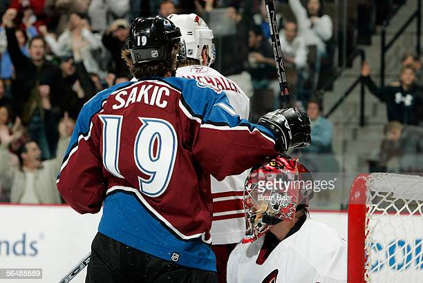 Joe Sakic of the Colorado Avalanche celebrates his second goal against Curtis Joseph of the Phoenix Coyotes in the first period on December 26 2005...