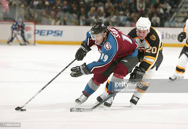 Joe Sakic of the Colorado Avalanche fights off Wayne Primeau of the Boston Bruins during the game on December 7 2005 at Pepsi Center in Denver...