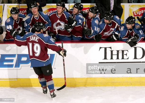 Joe Sakic of the Colorado Avalanche is congratulated by the bench after he scored the game winning goal in the shoot out on goaltender JeanSebastien...
