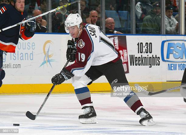 Joe Sakic of the Colorado Avalanche skates with the puch during the game against the New York Islanders at the Nassau Coliseum on December 17, 2005...