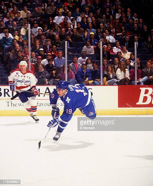 Joe Sakic of the Quebec Nordiques shoots during the game against the Washington Capitals on March 23, 1993 at the Capital Centre in Landover,...