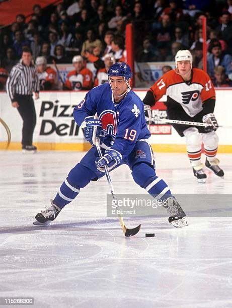 Joe Sakic of the Quebec Nordiques skates with the puck during an NHL game against the Philadelphia Flyers circa 1992 at the Spectrum in Philadelphia...