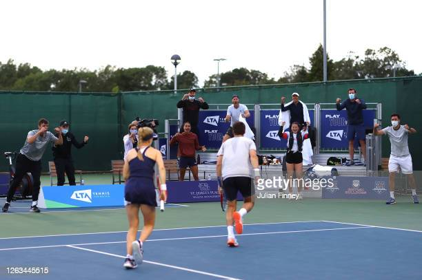Joe Salisbury and Harriet Dart of British Bulldogs celebrate during their mixed doubles match against Jamie Murray and partner Heather Watson of...