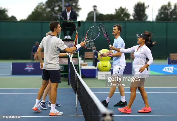 Joe Salisbury and Harriet Dart of British Bulldogs touch rackets in their mixed doubles match against Jamie Murray and partner Heather Watson of...
