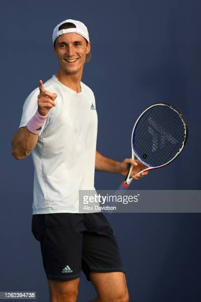 Joe Salisbury celebrates during his match with partner Kyle Edmund of the British Bulldogs interacts during their doubles match with Dan Evans and...