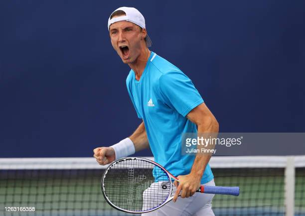 Joe Salisbury of British Bulldogs celebrates winning the first set during his men's doubles match with doubles partner Kyle Edmund against Andy...