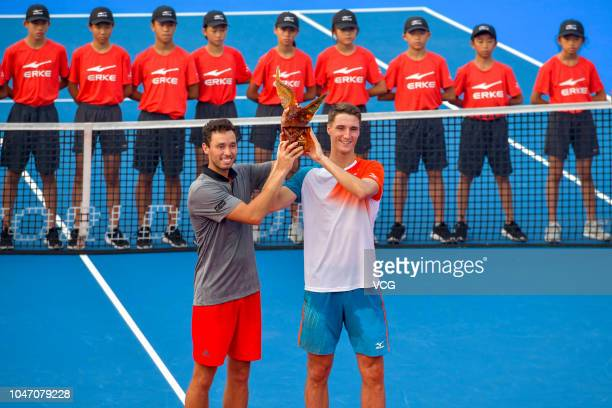 Joe Salisbury of Great Britain and Ben McLachlan of Japan hold the trophy after winning the Men's Doubles final match against Robert Lindstedt of...