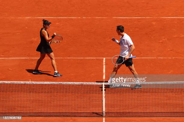 Joe Salisbury of Great Britain and playing partner Desirae Krawczyk of The United States celebrate in their Mixed Doubles Final match against Elena...
