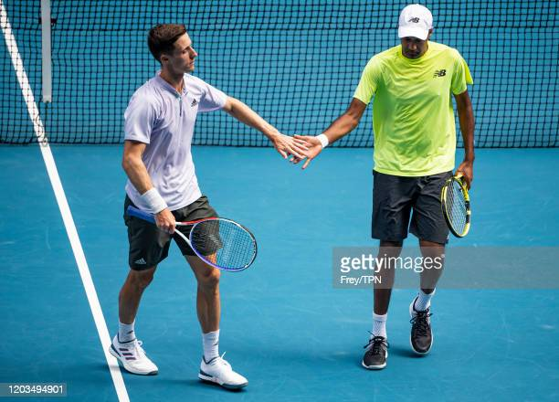 Joe Salisbury of Great Britain and Rajeev Ram of the United States in action in the men's doubles final against Luke Saville and Max Purcell of...