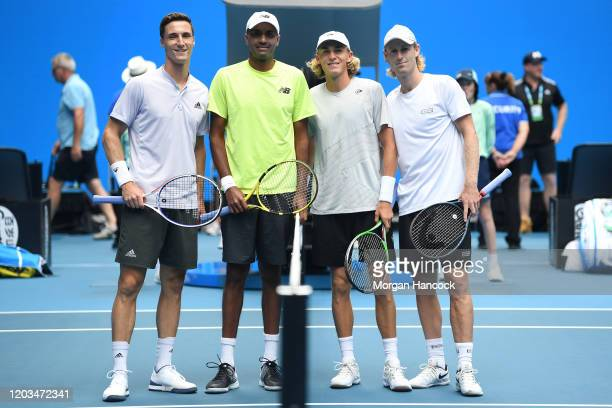 Joe Salisbury of Great Britain and Rajeev Ram of the United States pose with Max Purcell of Australia and Luke Saville of Australia before their...