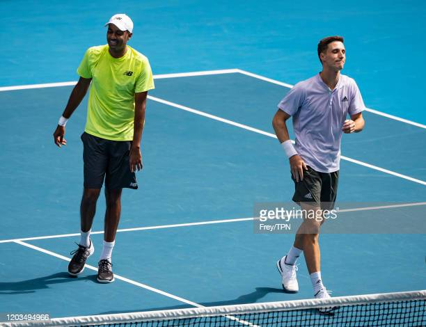 Joe Salisbury of Great Britain and Rajeev Ram of the United States celebrate winning the men's doubles final against Luke Saville and Max Purcell of...