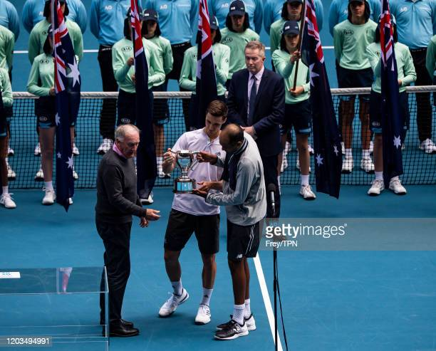 Joe Salisbury of Great Britain and Rajeev Ram of the United States celebrate with the trophy after winning the men's doubles final against Luke...