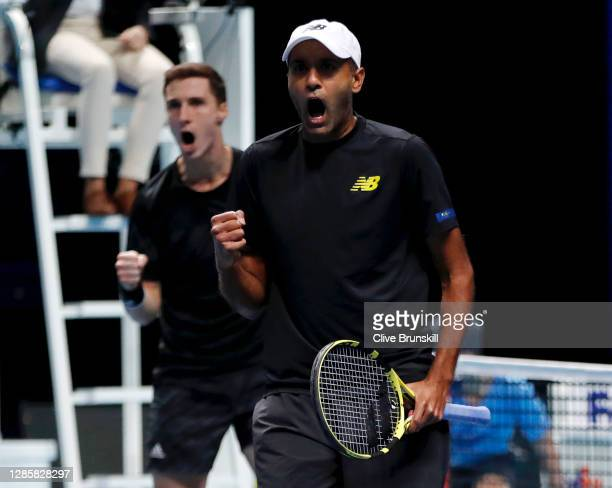 Joe Salisbury of Great Britain and Rajeev Ram of The United States celebrate match point during their round robin doubles match against Lukasz Kubot...