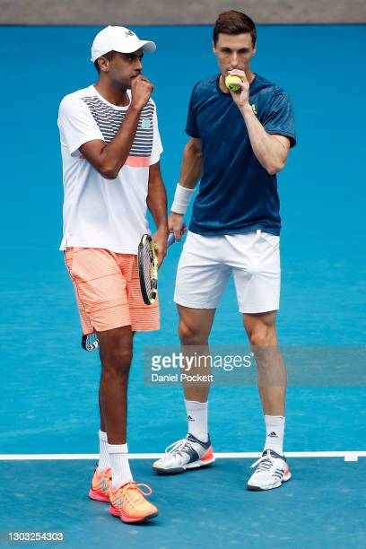 Joe Salisbury of Great Britain and Rajeev Ram of the United States talk tactics in their Men's DoublesFinal match against Ivan Dodig of Croatia and...